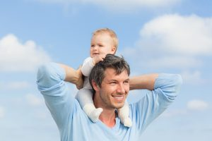 ICSI father with baby on his shoulders