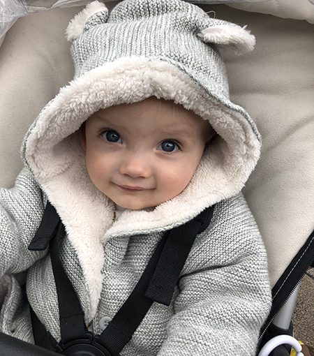 Baby with hood up